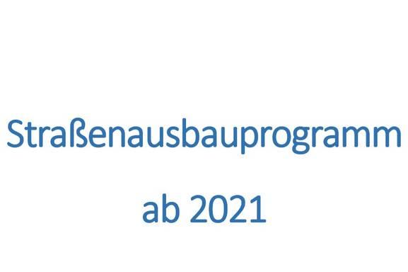 Auf dem Bild stehen Sie das Merseburger Straßenausbauprogramm ab 2021 mit dem Stadtwappen.